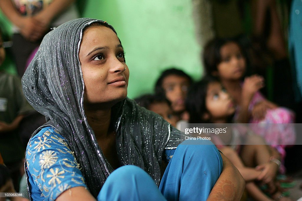india slum girl An Indian girl attends the worship at a slum church on June 6 2010 in New