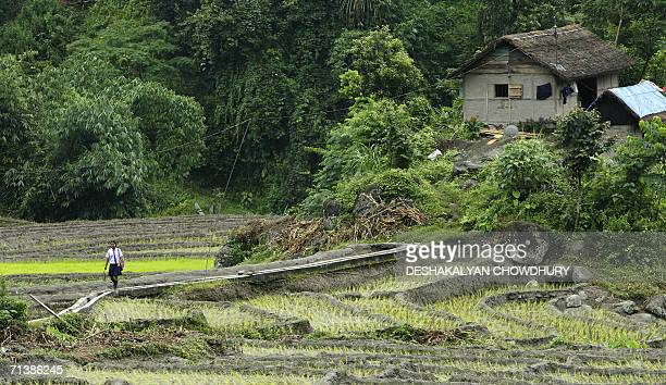 An Indian girl crosses a field on the way to her school at the village of Kitang close to Gangtok capital of India's northeastern state of Sikkim 07...