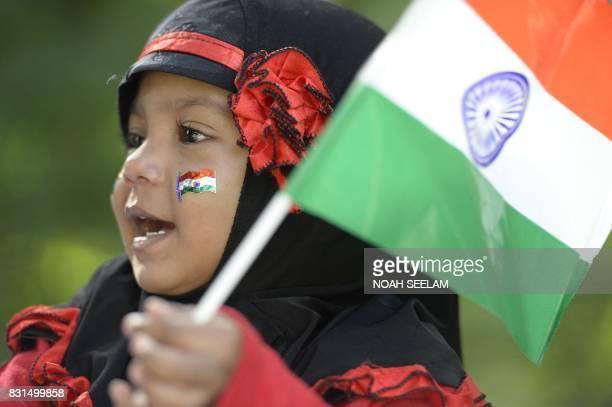 An Indian girl holds a flag during Independence Day celebrations in Secunderabad the twin city of Hyderabad on August 15 2017 Indian Independence Day...
