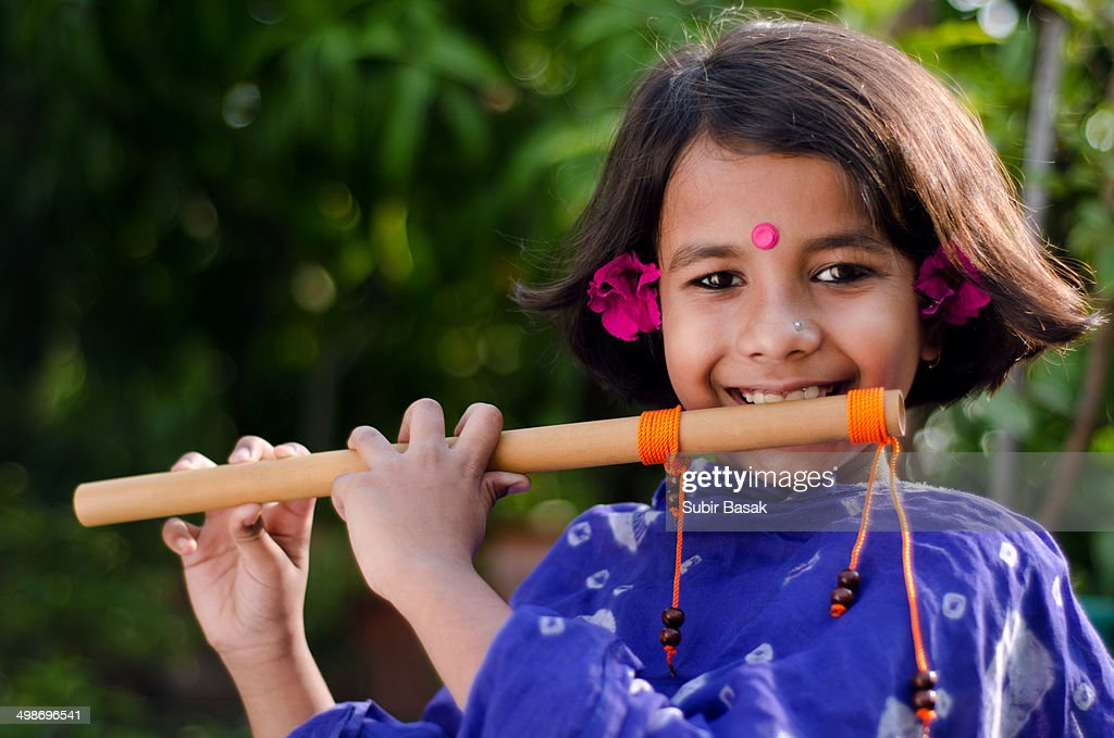 an indian girl with flute ストックフォト getty images