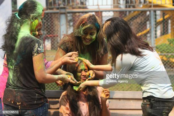 An Indian girl's face is smeared in color as she celebrates Holi, the Hindu festival of colors, in Mumbai, India on March 02, 2018. The festival, a...