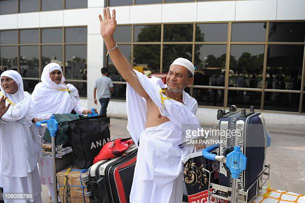 An Indian Haj pilgrim waves to relatives as he departs for Mecca at the Sardar Vallabhbhai Patel International Airport in Ahmedabad on October 26...