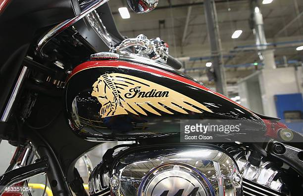 An indian head decorates the gas tank of an Indian Chieftain motorcycle sitting on the assembly line at the Polaris Industries factory on August 8...