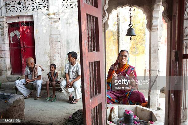 An Indian Hindu devotee chants prayers at a temple on a river bank early in the morning. India is the birthplace of four of the world's major...