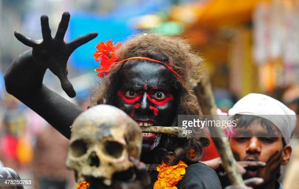 An Indian Hindu devotee holds a human skull during a procession for Maha Shivaratri dedicated to the Hindu god Lord Shiva in Allahabad on February 27...