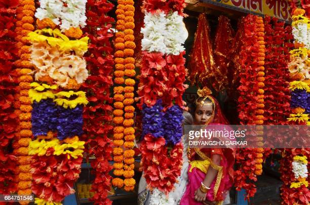 TOPSHOT An Indian Hindu girl arrives to take part in the Kumari Puja at the Adyapeath Ashram on the outskirts of Kolkata on April 5 2017 Kumari Puja...