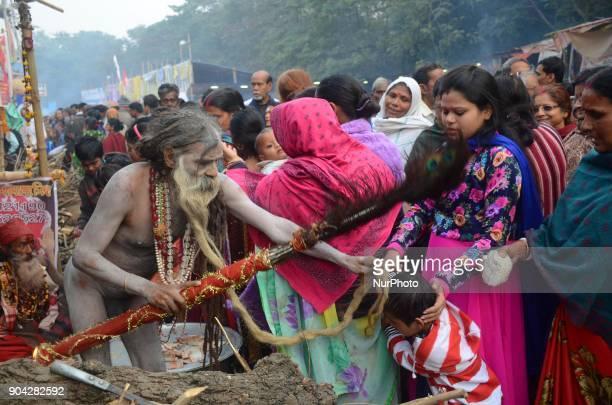 An Indian Hindu holy man blesses devotees at transit camp in Kolkata India on Friday 12th January 2018 Indian Hindu holy man starts to gather at...