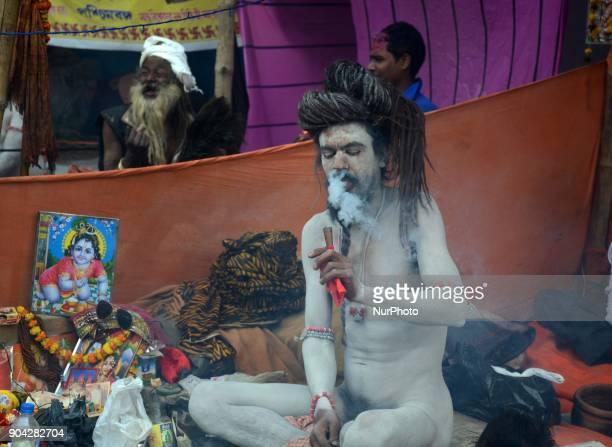 An Indian Hindu holy man smokes marijuana at transit camp in Kolkata India on Friday 12th January 2018 Indian Hindu holy man starts to gather at...