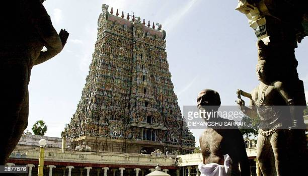 An Indian Hindu man walks past a gateway at the Meenakshi temple in the the southern Indian city of Madurai 18 January 2004 The Meenakshi temple...