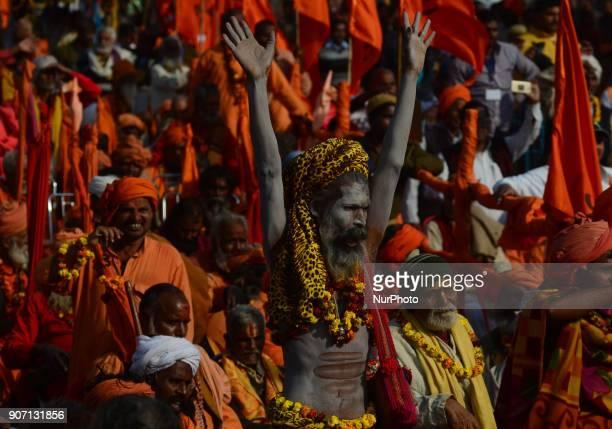 An indian hindu saint reacts on the speech of Uttar Pradesh state Chief Minister Yogi AdityaNath from his cell phone during Vishwa Hindu Parishad 's...