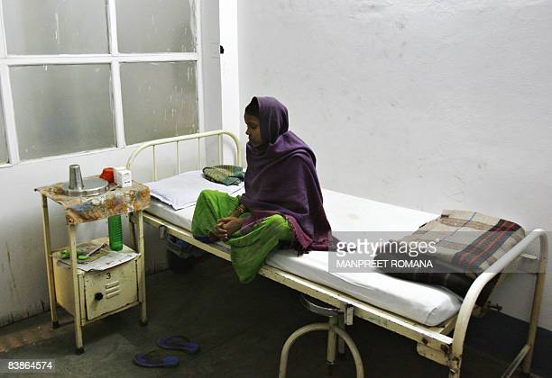 An Indian HIV positive woman rests on her bed at Community Care Centre run by The Women's Action Group Chelsea in New Delhi on November 26 2008 The...