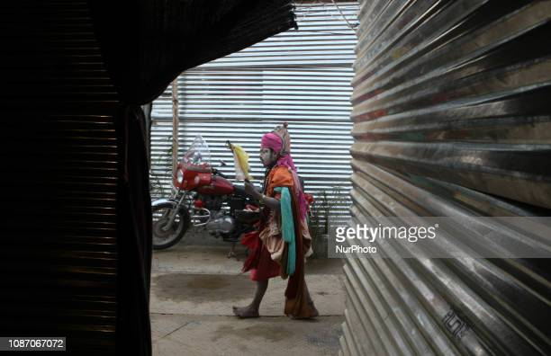 An indian holy man of Alakh Community goes out to ask alms in various religious community camps during Kumbh Mela in Allahabad on January 23 2019...