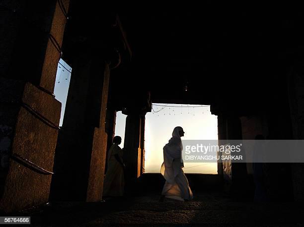 An Indian Jain nun arrives on Vindhyagiri hill to pray at the 588 foot monolith of Gomateshwara in Shravanabelagola around 160 KM west of Bangalore...
