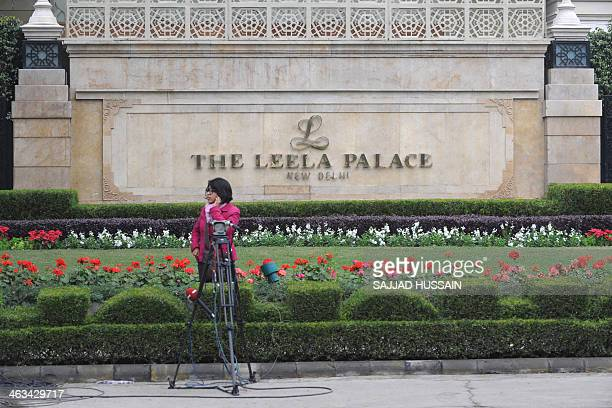 An Indian journalist speaks on her mobile phone outside the Leela Hotel where the wife of India's Human Resources Minister Shashi Tharoor Sunanda...