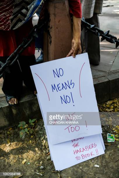 An Indian journalists holds a placard at a protest against sexual harassment in the media industry in New Delhi on October 13 2018 India's #MeToo...
