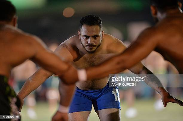 An Indian kabaddi player attempts to tag a Pakistani opponent during their final match of the 3rd Asian Kabaddi Circle Style Championship 2016 in Wah...