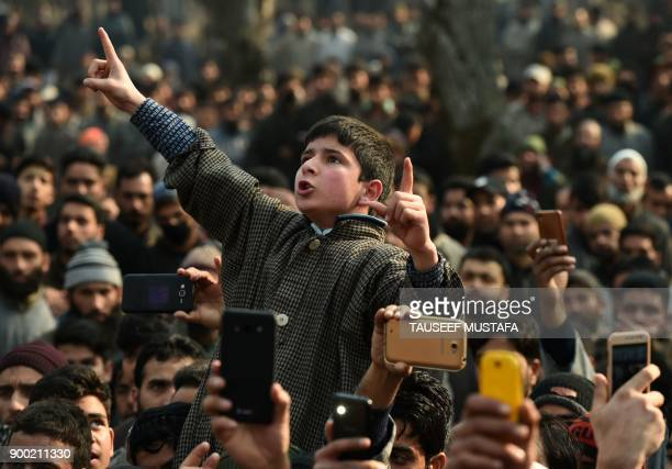An Indian Kashmiri boy shouts proindependence slogans during a funeral of a 16 year old rebel Fardeen Ahmad Khandey in Tral area of South Kashmir on...