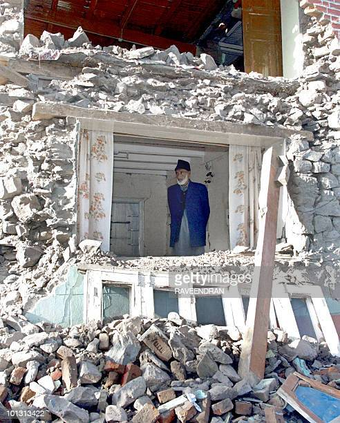 An Indian Kashmiri man surveys the damage to his home which was destroyed by a 76 magnitude earthquake two days before in Uri some 110 kms from...