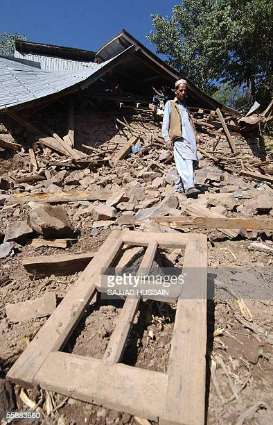 An Indian Kashmiri man walks around his damaged home after an earth quake in Jabla some 110kms north of Srinagar 09 October 2005 The confirmed...