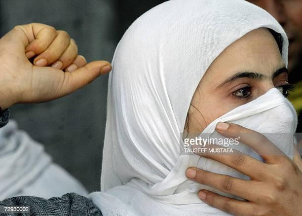 An Indian Kashmiri Muslim chants slogans during a demonstration against the execution of former Iraqi President Saddam Hussain in Srinagar 05 January...