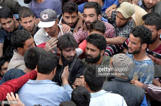 An Indian Kashmiri rebel mourns during the funeral of rebel commander Sabzar Ahmad Bhat in Rathsuna Tral near Srinagar on May 28 2017 Authorities...