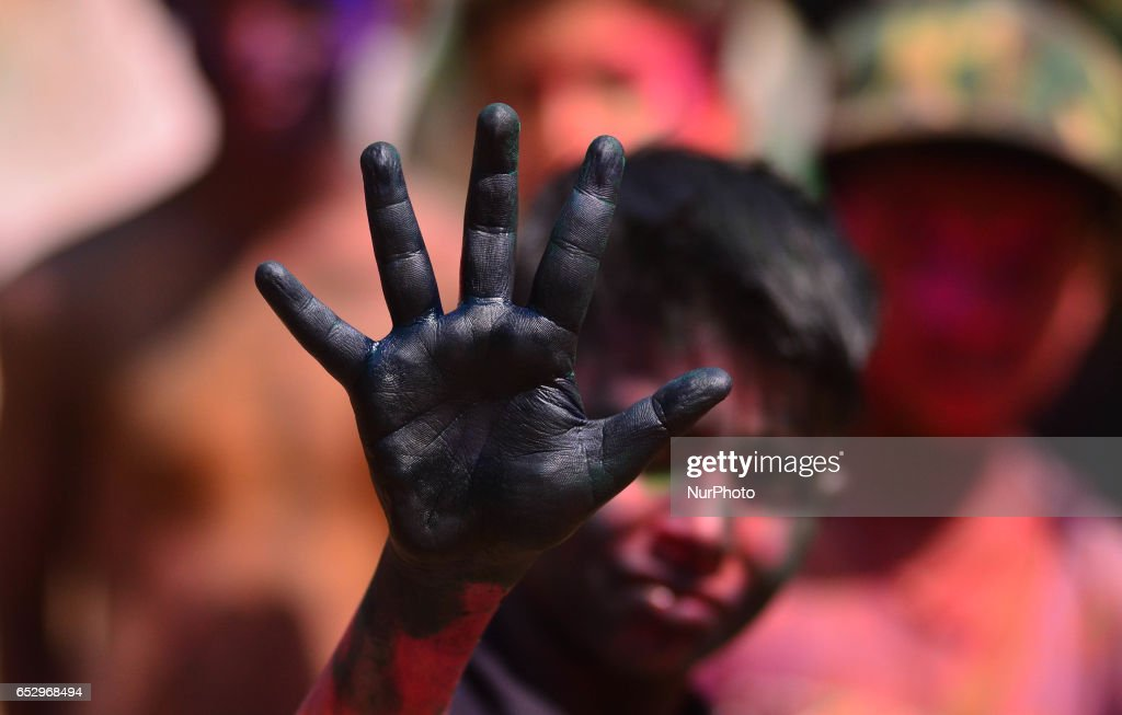 An Indian kid shows his water colour hand during Holi celebration in Dimapur, India north eastern state of Nagaland on Monday, March 13, 2017. Holi, the festival of colours, is a riotous celebration of the coming of spring and falls on the day after full moon annually in March.