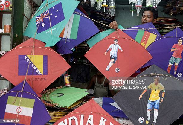 An Indian kite maker arrange kites bearing pictures of Portuguese soccer player Cristiano Ronaldo Brazilian soccer player Neymar and Argentine soccer...