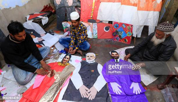 An Indian Kitemaker Abdul Gaffur gives a final touch to his kites made from the cut out of Bollywood actress Anushka Sharma Indian cricketer Virat...
