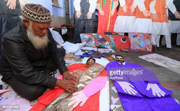 An Indian Kitemaker Abdul Gaffur gives a final touch to his kites made from the cut out of Bollywood actress Anushka Sharma and Indian cricketer...