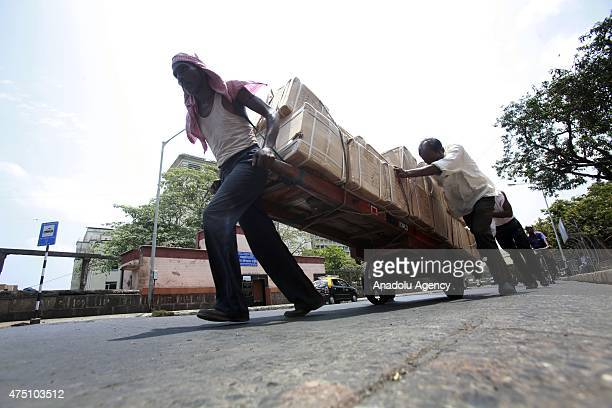 An indian laborer pulls cart at a hot day in Mumbai on May 29, 2015. At least 1400 people have died in a major heatwave that has swept across India,...