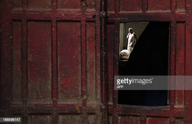 An Indian labourer takes a break inside a warehouse in the Old Quarters of New Delhi on May 12 2013 The Indian government forecasts the economy will...
