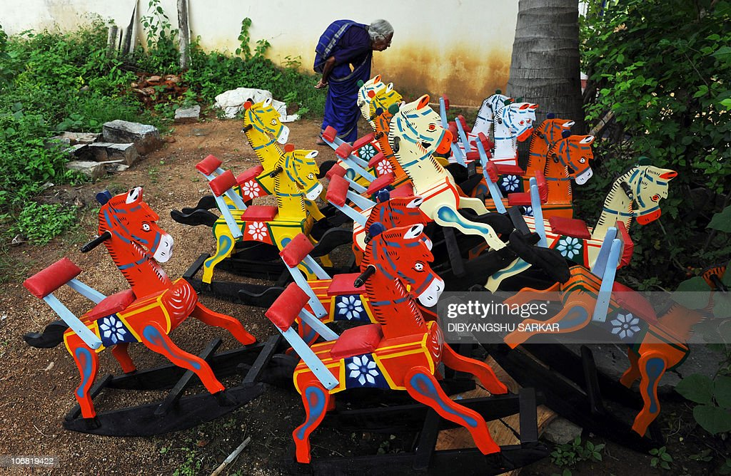 An Indian Lady Walks Past Wooden Rocking Pictures Getty Images