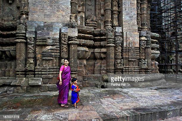 An Indian lady with baby in Konark temple