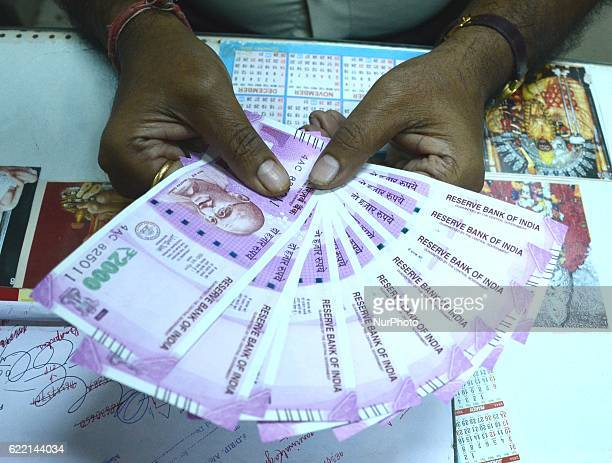 An Indian man displays 2000 rupees note after exchanging the money from bank in in Kolkata India on Thurseday 10th November 2016The government on...