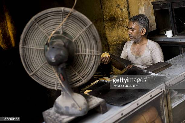 An Indian man sells bread in New Delhi on June 24, 2009. India's annual inflation rate slipped into negative territory for the first time in 30 years...