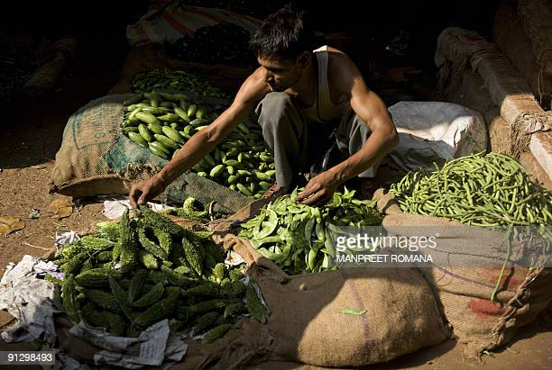 An Indian man sells produce at a vegetable market in New Delhi on October 1, 2009. Indian inflation accelerated sharply as the weakest monsoon in...