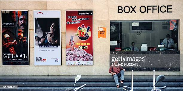 An Indian man sits on the steps of a box office of a multiplex cinema in Mumbai on April 4, 2009. Bollywood film producers went on strike on April 4,...