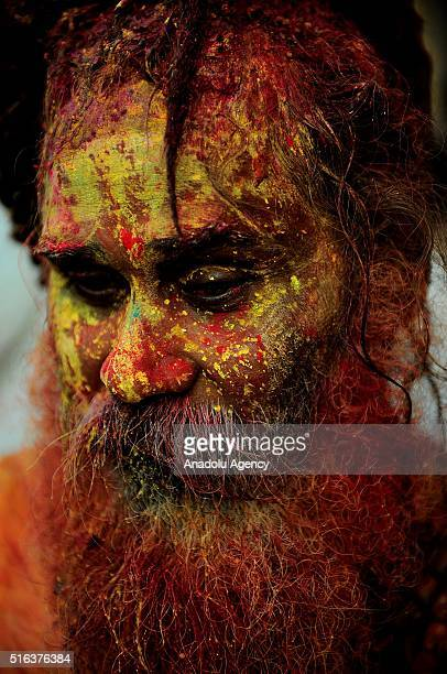 An Indian man smeared with coloured powder takes part in the Holi Festival celebrations in Mathura India on March 18 2016 Holi the festival of...