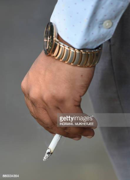An Indian man smokes a cigarette in Mumbai on November 27 2017 A global treaty to fight the health impact of tobacco has suffered substantial...
