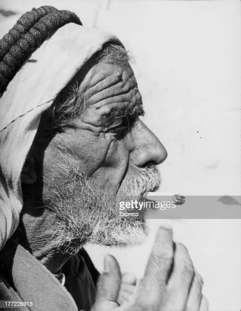 An Indian man smoking a hashish cigarette circa 19601975