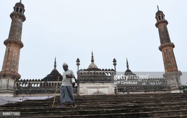 An Indian man walks down the stairs next to the mosque at the Bara Imambara a colossal imambara complex in Lucknow northern India on August 25 2017 /...