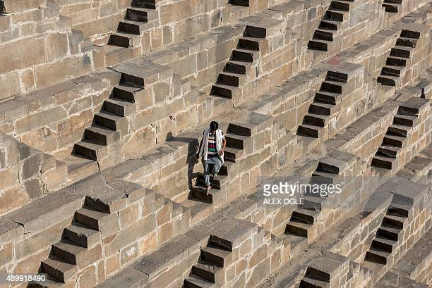 An Indian man walks down the steps of the historic Chand Baori stepwell in Abhaneri village in Rajasthan on September 24 2015 For a few hours on one...