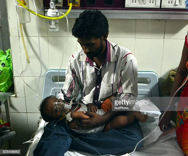 An indian manfather of patient childsuffering from malariatake cares in emergency ward at Sarojini Naidu Children HospitalAllahabad on September 32015