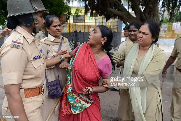 An Indian member of the Dalit caste community is detained during a protest against an earlier attack on Dalit caste members in the Gujarat town of...