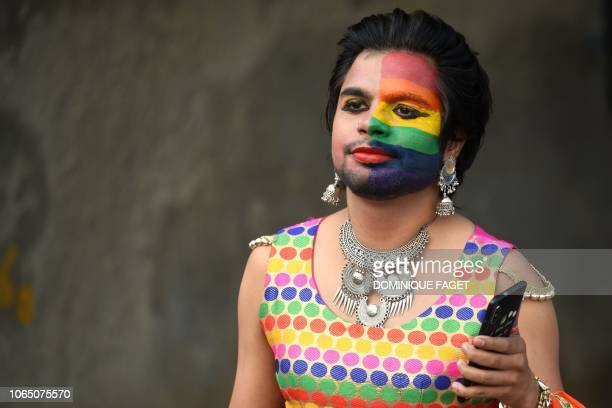 An Indian member of the lesbian gay bisexual and transgender community takes part in a pride parade in New Delhi on November 25 2018 Thousands of...