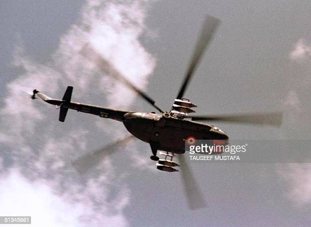 An Indian Mi17 helicopter gunship flies over the Drass region of Kashmir 29 May 1999 Insurgents from Pakistan shot down an Mi17 28 May a day after...
