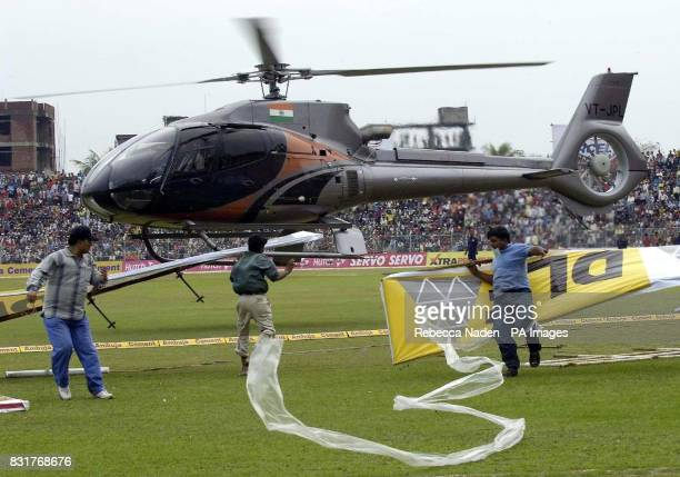 An Indian military helicopter attempts to dry the outfield at the Nehru Stadium Guwahati India Sunday 9th April 2006 The 5th ODI between India and...