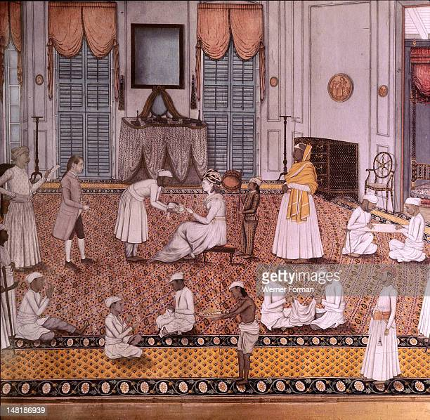 An Indian miniature showing the wife of a British officer attended by numerous servants The setting is a European style house interior mixing...
