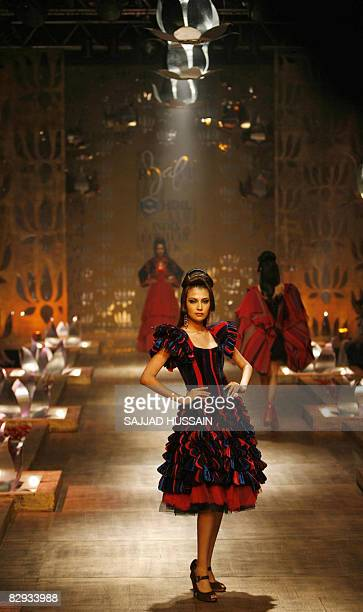 An Indian model displays a creation by Indian designer Rohit Bal on the final day of the HDIL India Couture Week in Mumbai on September 21 2008 India...