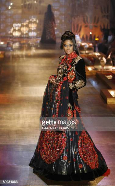An Indian model displays a creation by Indian designer Rohit Bal on the final day of the HDIL India Couture Week on September 21 2008 in Mumbai India...